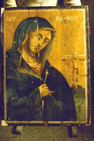 Virgin Marry icon varnish removed and replacement of the corners