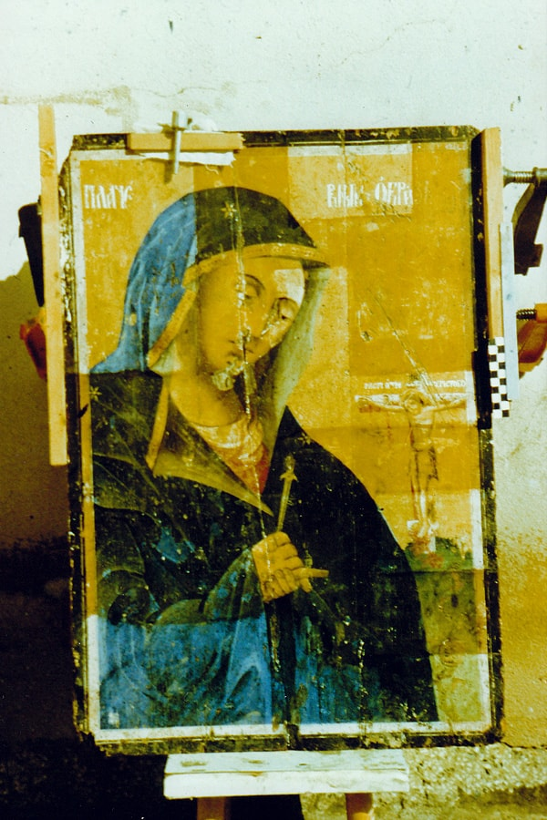 Virgin Marry icon varnish removing back